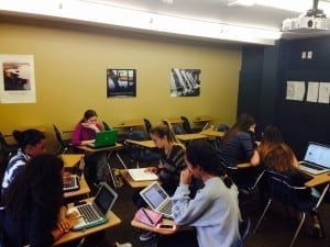 Students working on their computers in a classroom.